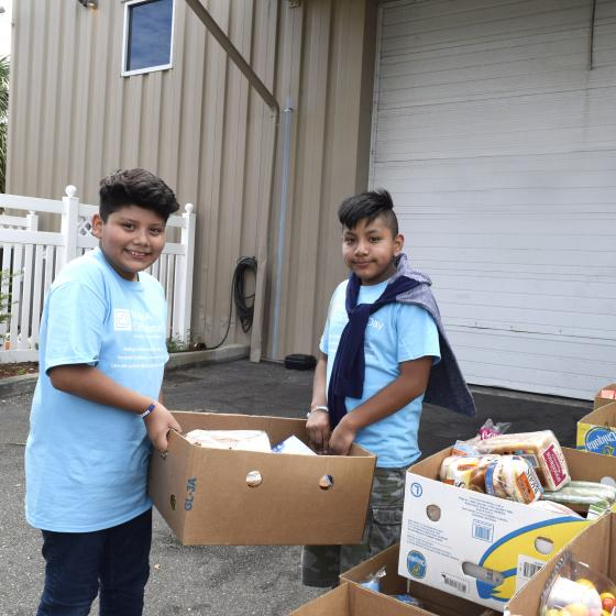 Boys delivering food in Pinellas County, FL